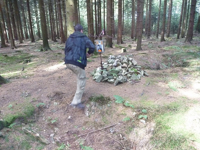 An area of many foxholes ..Behind the memorial is the edge of the wood and open fields