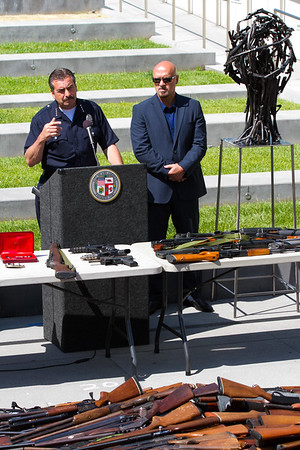 "LAPD Chief Charlie Beck and L.A. Sculptor Victor Hugo Zayas discuss the project ""Turning Violence Into Art."" Zayas created sculptures like the one at right that were made from pieces of ground up guns collected in an LAPD buy back program. The sculptures were displayed at the Laguna Art Museum and garnered world wide media attention. I photographed the entire process from gun collection by the LAPD Swat Unit, to guns being ground, delivered to Zayas and the sculpture creation. 15 of my images were displayed in the Laguna Art Museum catalog and several images were displayed in the museum."