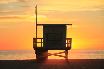 The sun streaming underneath the lifeguard tower caught my eye....