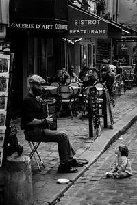 Child and accordion player, Paris.