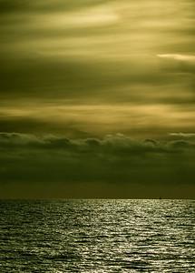 Sailboat in the distance at sunset, near the Manhattan Beach Pier.