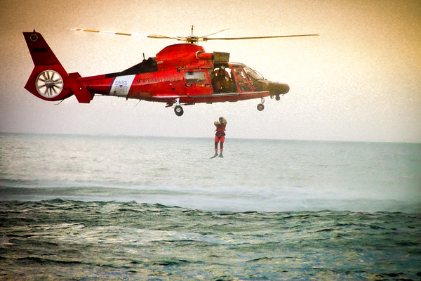 Coast Guard Rescue Team practices recovery dives near Redondo Beach, CA. Extremely high shutter speeds reveal the rotor details in mid-flight.