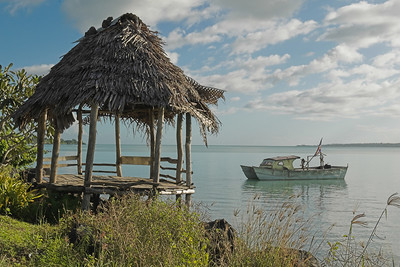 A traditional fale (a very small one) and a slightly less traditional fishing boat.