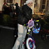 She won a bike! Major General and Mrs. Brown welcomed Fort Benning families to meet Santa at Riverside Dec. 9, 2010.  The annual event, sponsored by MWR's Child, Youth and School Services, included free treats and activities and prizes.  Photo by Bridgett Sharp Siter for Fort Benning Directorate of Family and Morale, Welfare and Recreation.