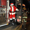 Major General and Mrs. Brown welcomed Fort Benning families to meet Santa at Riverside Dec. 9, 2010.  Santa arrived by firetruck - another Fort Benning tradition. The annual event, sponsored by MWR's Child, Youth and School Services, included free treats and activities and prizes.  Photo by Bridgett Sharp Siter for Fort Benning Directorate of Family and Morale, Welfare and Recreation.