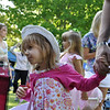 A young girl waits her turn in line to see the Easter bunny during the annual Spring Eggstravaganza April 16 on the lawn of Riverside. More than 3,500 people attended the event, which included egg hunts, prizes, games, inflatables, dancing and more. Photos by Bridgett Sharp Siter for Fort Benning MWR.