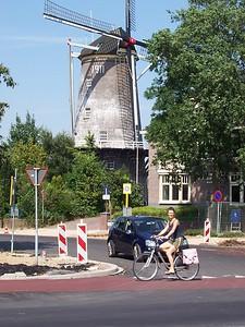 Caroline rides past a windmill in Veenendaal.