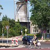 Caroline rides past a windmill in Veenendaal.