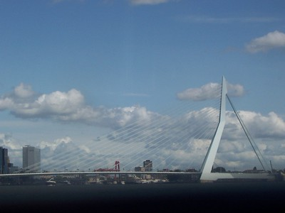 The Erasmus Bridge (also known as the Swan Bridge) is the gateway to Rotterdam's ship channel.