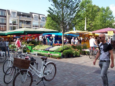 The open market in Veenendaal. The open market is every Tuesday and Saturday. Vendors sell fruit, flowers, cheese, meat, bread and many other items.