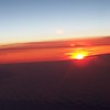 Sunrise over Greenland from 35,000 feet.