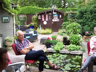 Caroline's dad relaxing with family in the garden before dinner.