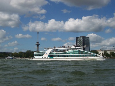 A day cruise boat passes the Euromast tower.