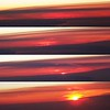Photo progression of the sunrise over Greenland from 35,000 feet.