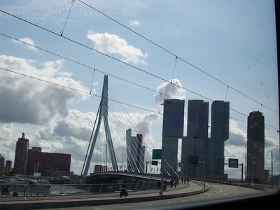 "Rotterdam's ""Swan"" bridge (Erasmus bridge) and de Rotterdam towers in the background."