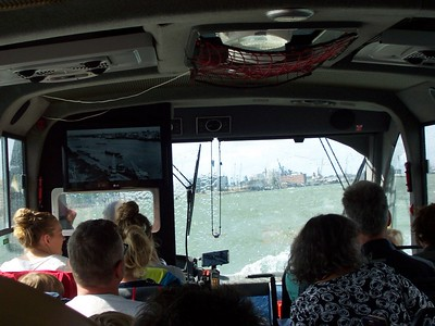 Water surges up the windshield of our bus as we cruise the ship channel in Rotterdam.