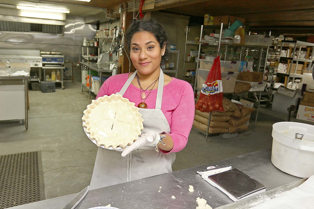 . Hollis Hills Baker Carla Alvarez shows off one of the chicken pot pies that they will be bringing to Gov. Charlie Baker for his Super Bowl LII bet with the governor of Pennsylvania. SENTINEL & ENTERPRISE/JOHN LOVE