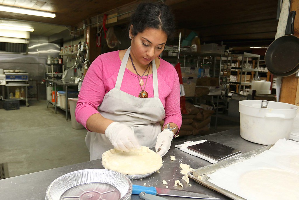 . Hollis Hills Baker Carla Alvarez makes some chicken pot pies that they will be bringing to Gov. Charlie Baker for his Super Bowl LII bet with the governor of Pennsylvania. Here she gets the home made crust read for the pie filling. SENTINEL & ENTERPRISE/JOHN LOVE
