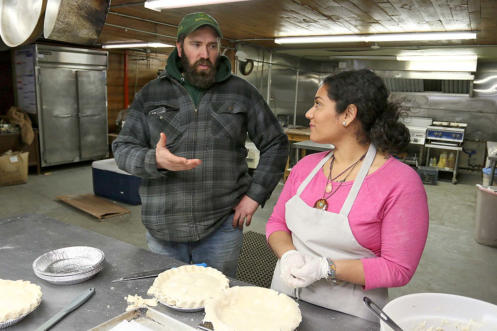 . Hollis Hills owner Jim Lattanzi chats with Baker Carla Alvarez as she makes some chicken pot pies that they will be bringing to Gov. Charlie Baker for his Super Bowl LII bet with the governor of Pennsylvania. SENTINEL & ENTERPRISE/JOHN LOVE