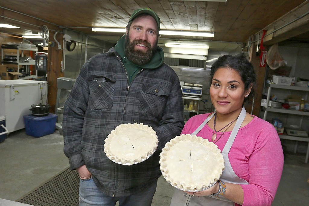 . Hollis Hills owner Jim Lattanzi and Baker Carla Alvarez show off two of the chicken pot pies that they will be bringing to Gov. Charlie Baker for his Super Bowl LII bet with the governor of Pennsylvania. SENTINEL & ENTERPRISE/JOHN LOVE