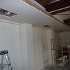 Interior of the garage, north wall.  Flush mounted down lights have been added to the underside of the new soffit and ceiling lighting on the top.