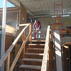 """The concrete header beam which spans the length of the living room entry, was found to be sagging by about 1"""" in the center.  This condition would make it impossible for us to replicate and install the original-style bi-folding doors.  The doors would not be able to be opened and closed with this much sag in the header.  Because of this, it was decided to remove the header and replace it with a steel I-beam that will be encased in a lightweight concrete.  Here, a GSD worker is removing the concrete header beam.  The beam is 28' in length."""