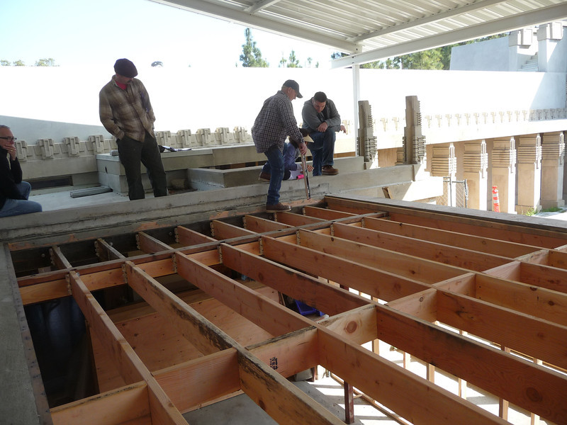 In a restoration project like this, where you never know what you are going to find, many design changes may be required.  Here, the project architect is discussing some of these changes and drawing them up on-site.  Haviing this type of flexibility in the field while performing the work in a design/build fashion, is key to completing a complicated project like this.  Working with the Bureau of Engineering as the architect and the General Services Department as the general contractor makes this possible.