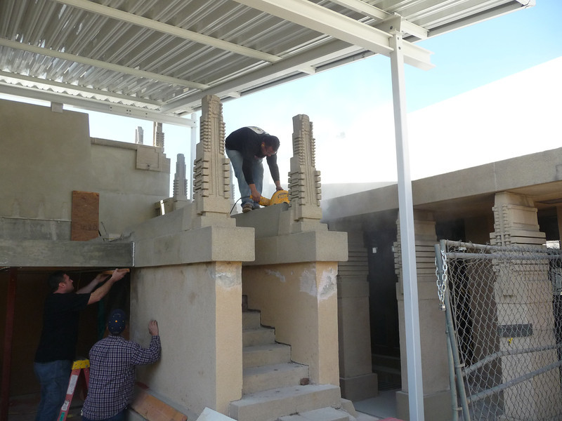 In this image, the cast concrete capstones are being removed from the top of the stairway.