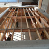 Next, new roof joists are installed in the living room entry.