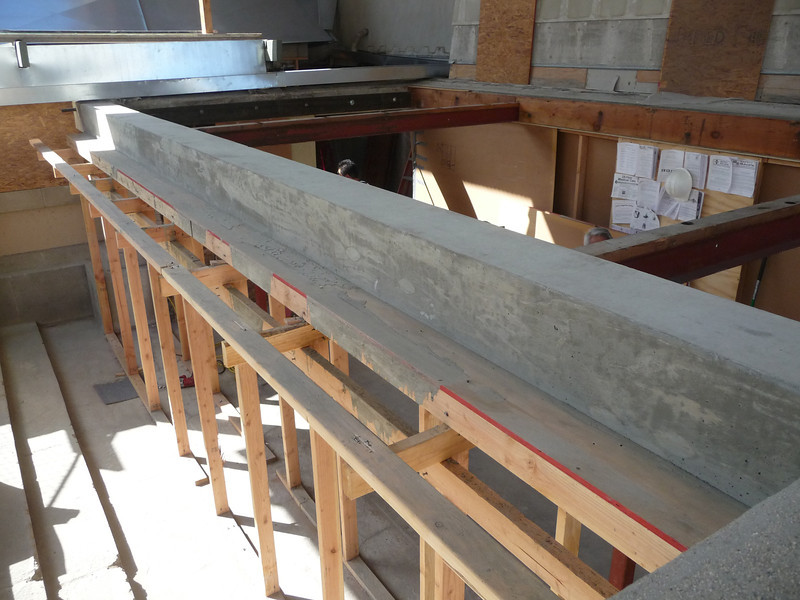 Now we move on to the 28' long beam in the living room entry.  The concrete has cured enough for the forms to be pulled.