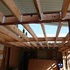 View of the living room entry roof/ceiling joists from below.