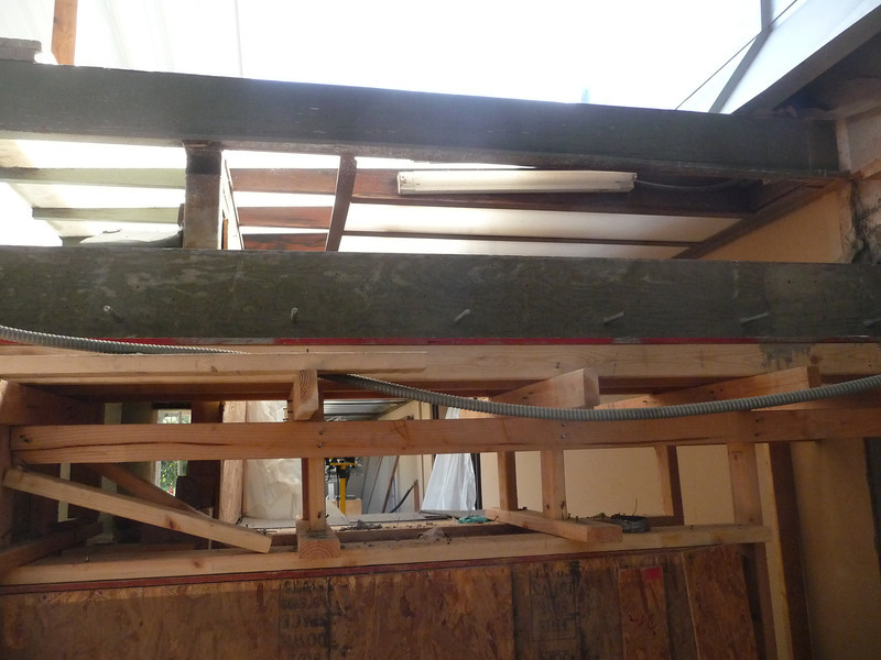 Once the concrete has had time to cure, the wood form is pulled.  This is the 12' span in the south hallway.