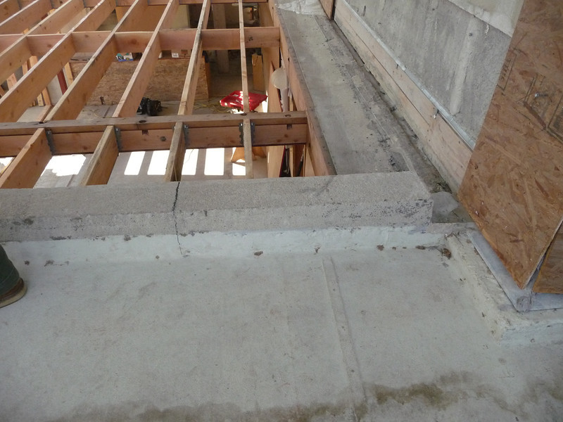 This concrete berm was also added to the living room entry roof during the 1945 renovation.  Due to constant leaks, the roof over the entry was simply removed, and the entry became a part of the exterior.  This berm was added to control the drainage. The roof was reinstalled in the 1970s, but we are rebuilding it in this phase of work.