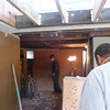 Here we are starting work in the north hallway, adjacent to the living room entry.  All of the plaster is being removed so that we can repair the ceiling joists (termites and wood rot), and replace the roof drain that is located in a wall.