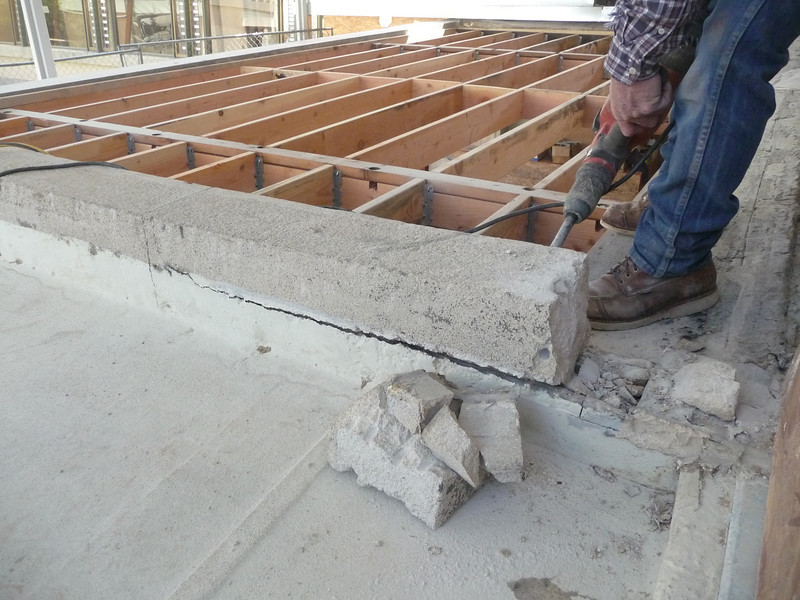 There were a few dowels set into the concrete, but there were no other mechanical means of attaching the berm.