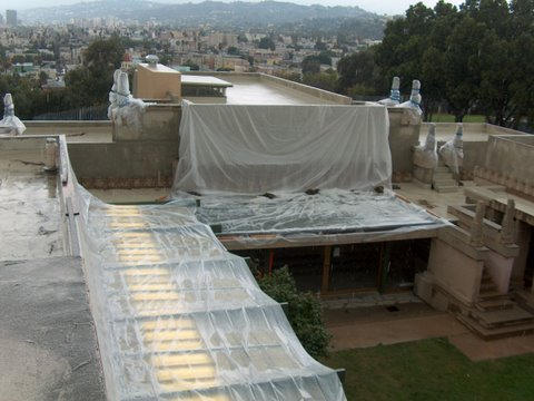 Every time it rained, plastic sheeting had to be installed.  This was very labor intensive, and would always allow water into the structure during the initial rain.  Plus, it had to be repaired/replaced during long rainy spells because the wind would cause the plastic to tear.