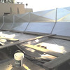 Close-up of galvanized panels installed over pergola roof parapet, looking south.