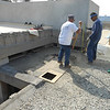 GSD carpenters removing the old leaking roof system.