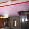 The ceiling of the main entry has been repaired and is now ready for plaster.  The area covered by the red tape and plastic is the wood base for the new ceiling molding.