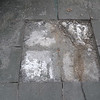 Once a few of the tiles have been removed, you can see that the cracks extend to the concrete base below.  This is not looking good.