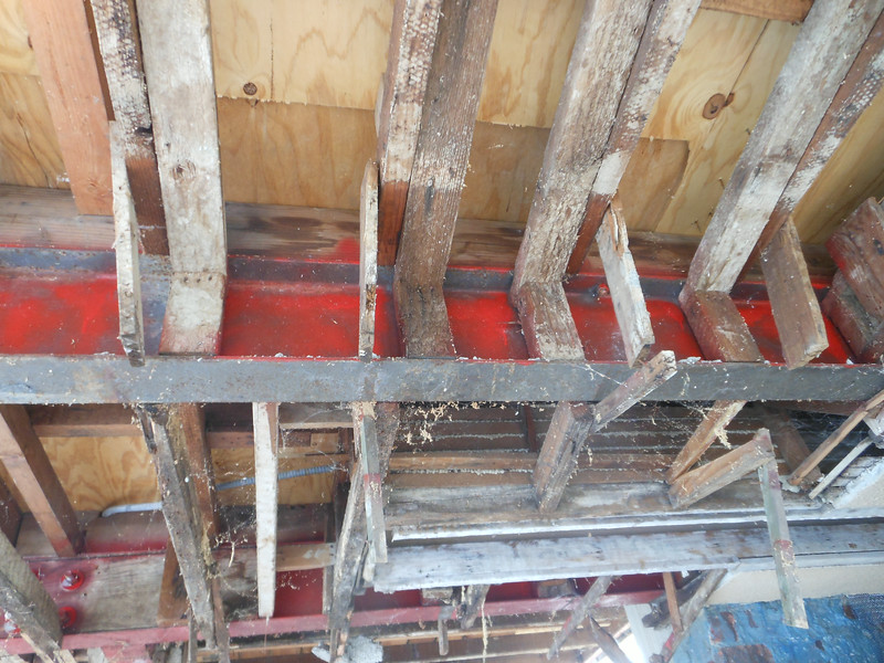 "Here you can see that the steel I-beams were furred out (framed) inadequately using 1"" thick wood."