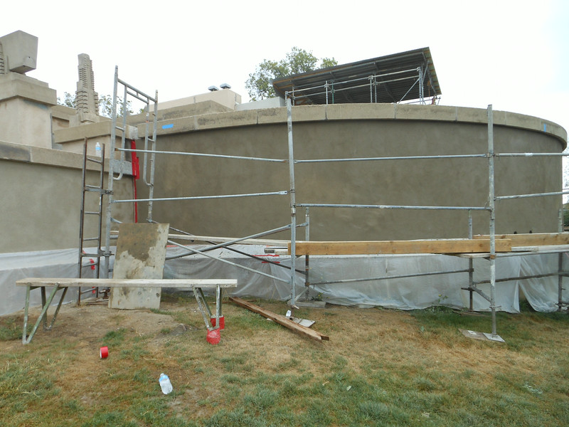 Continuing with the application of the correct stucco finish around the structure.  Here, the terrace wall has just had the finish coat applied.