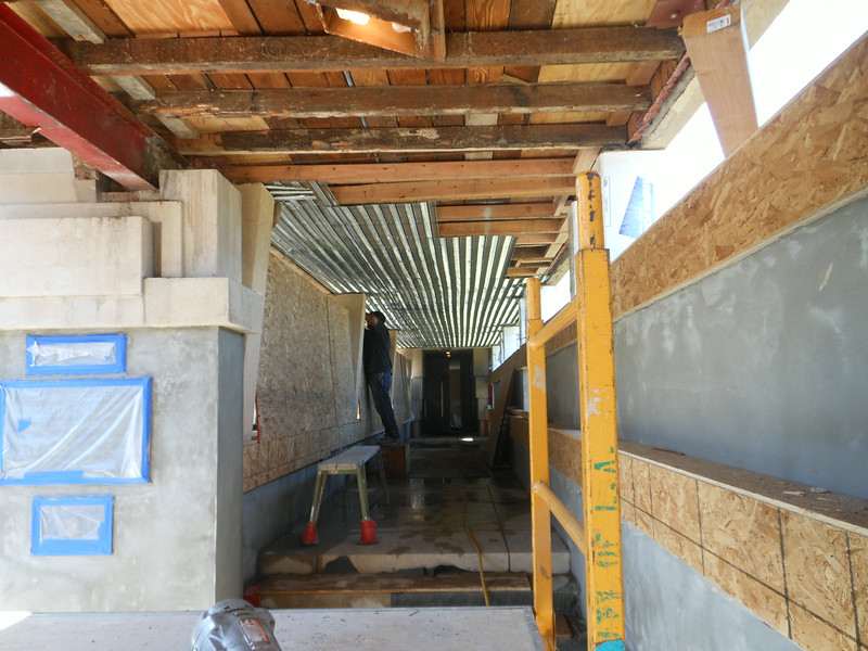 Looking towards the front doors.  Once the damaged framing has been replaced or reinforced, steel mesh lath is installed.