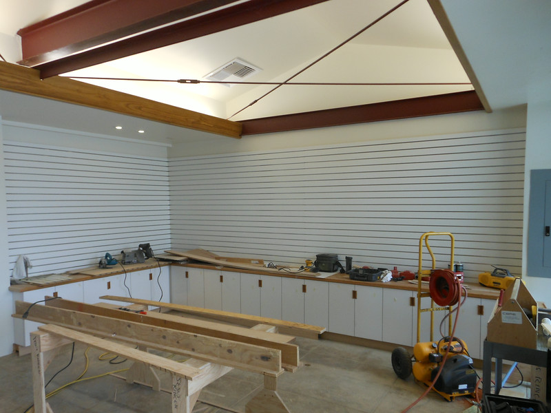 Work to convert the garage into a visitors center continues.  The cabinets, countertops, and adjustable wall shelving system have been installed.