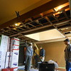 The light box in the center of the ceiling is the low spot.  To level the ceiling, new lumber will be added.
