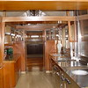 Two views of the Kitchen which was remodeled in 1946 and again in 1974.  Notice the counter tops in all of their 1970s wood grained formica glory!  During the 1974 rehabilitation, the counter tops were changed from mahogany to formica.  Since we didn't know exactly what the kitchen counter tops were in 1921, it was decided to return it to its earliest known iteration - hence 1946.