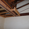 To hide some of this seismic retrofitted steel truss work, we will frame around it with wood, cover it with drywall, and then paint it.  Here you can see that the steel I-beam has been sandwiched with lumber.  This will also create a soffit that will allow us to install up-lighting that will be hidden from view.