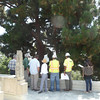 This is a pre-bid meeting with tree specialists to inspect the job site.