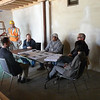 We moved our salvaged table inside the garage and found some chairs - the makings of our new construction office.  This is one of our weekly construction meetings.  The General Services Department (GSD) Construction Division is the general contractor for this Phase III project, The Bureau of Engineering (BOE) Architecture Division, is the project architect/manager, The Cultural Affairs Department (CAD) is the curator, and Project Restore is the restoration specialist and grants manager.