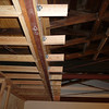 The short pieces of wood will form the frame for a soffit.  Up-lighting will be installed above this soffit.